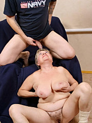 Bigtitted mature playing with a big toy