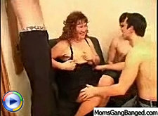 Busty mature lady gathered three guys together for some nice gangbang and she stand on her four asking the guys fuck her doggy-style