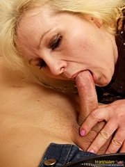 Chubby mature blonde in sexy black stockings swallows young guy's cock and caresses his nuts
