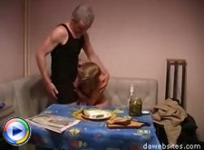 Young chick gets a lesson in fucking from an old guy in the kitchen