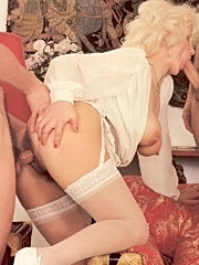 Hairy seventies lady receives two hard cocks