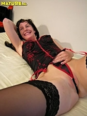 Horny mature nympho playing with her toys