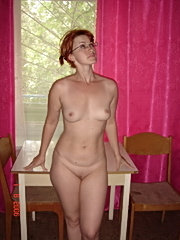 Amateur mature with small tits doing her muff with two dildos