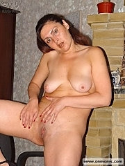 Hot mature lady stripping and wanking