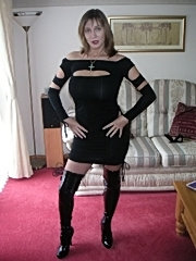 Busty milf spreading her legs in boots