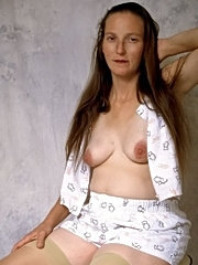 Mature brunette displaying pussy