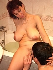 A guy caught his aged woman professor in the bath and fucked her.