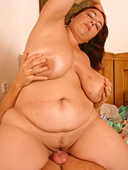 Chubby mature ho bouncing on a fat young dong