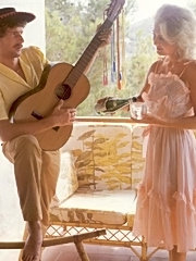 Seventies man giving a serenade to his lover