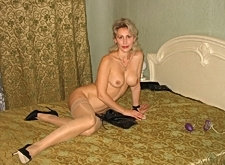 Big tits mature amateur spreads her pussy