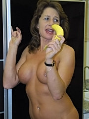 Horny milf cheryl displays her shaved pussy