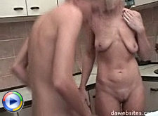Hot mature blond bitch fucks her son's friend right in the kitchen