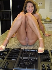 Cheryl strips to show off her luscious pussy