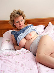 Mature mom gets a big black cock in her old cunt