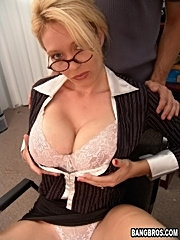 Buxom blond mom in a suit and heels bends over the desk for fun