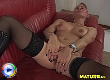 Blonde mature housewife playing and getting wet