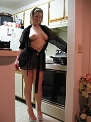 Sassy wife with monster titties lifts her skirt