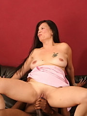 Sexy asian mommy yummi bounces on huge black meat and jizz bombed