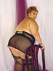 Nasty big lady poses and spreads on her chair
