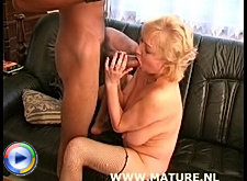 Big titted granny fucking and sucking a black dude