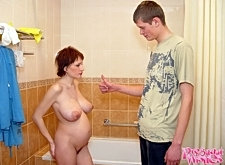 Shorthaired pregnant beauty takes a shower and kneels down to suck guy's beefy cock