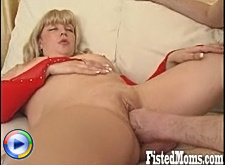 Mature slut fisting herself and fucked by a black man