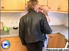 Blonde milf getting busy with the tattooed guy right in the kitchen and the guy is really awesome fucker