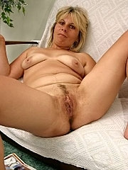 Blonde milf  showing her mature  body.