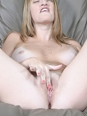 Mature blonde with fresh pink lipped pussy