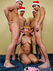 Sexy mature redhead getting banged by four horny santas and taking cumshots all over her face