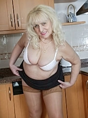 Sexy granny gets off in the kitchen