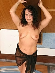 Horny brunette mom showing mature body.