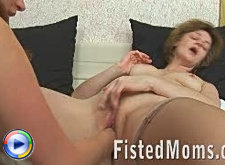 Mature blonde loves fisting with licking
