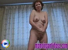 Lewd housewife in pantyhose shows off and masturbates