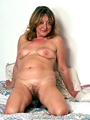 Inflammable granny gladly shows off her small saggy tits and puffy labia