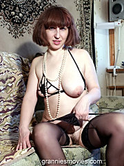 Horny mature with full saggy tits packs her beads deep into the hairy pussy