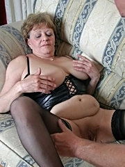 Big tit mature sucks cock