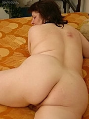 Mature woman  undressing and showing body.