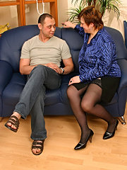 Mature fatty gives head to her younger lover and rides his cock on a couch