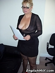Blonde milf with massive titties shows her ass