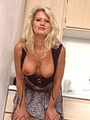 Sexy older wife licking up a load of cum