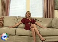 Mature blonde milf lifts her dress and spreads