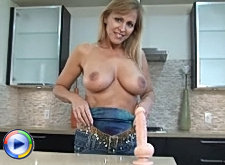 Busty anilos vixen nicole moore eagerly shows off her massive milf tits