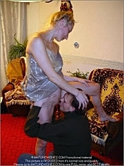 Dissolute blonde mature with thin body seducing a guy, getting naked and petting him in a living room