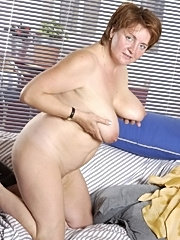 Busty older mom fingering her hairy pussy