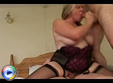 Sexy granny in lingerie fucks her naked housekeeper