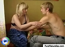 It gets really hot after a cup of tea so milf and her young lover decide to undress and make it even hotter