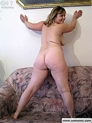 Plump mom with big tits posing .