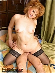 Mature redhead uses her skillful mouth to please her lover