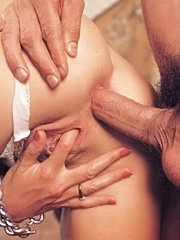 Inspecting her firm eighties ass with a cock